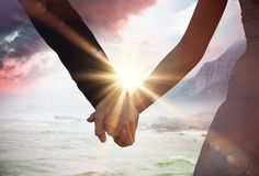 Composite image of mid section of newlywed couple holding hands in park Stock Images
