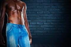Composite image of mid section of shirtless muscular man Stock Image