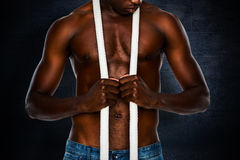 Composite image of mid section of shirtless muscular man Royalty Free Stock Images