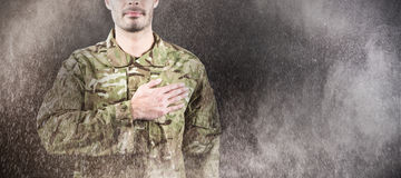 Composite image of mid section of soldier taking oath stock photo