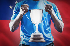 Composite image of mid section of sportsman holding trophy Stock Image