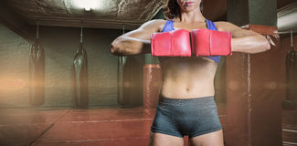 Composite image of midsection of boxer flexing stance Stock Photo