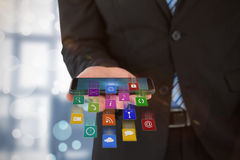 Composite image of midsection of businessman holding mobile phone 3d Stock Photos