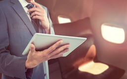 Composite image of midsection of businessman holding tablet computer Royalty Free Stock Photos