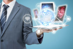 Composite image of midsection of businessman holding tablet computer 3d Royalty Free Stock Photos