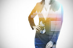 Composite image of midsection of businesswoman with hands on hip 3d. Midsection of businesswoman with hands on hip against business interface with graphs and Royalty Free Stock Images