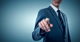 Composite image of midsection of elegant businessman pointing. Midsection of elegant businessman pointing against grey vignette stock photography