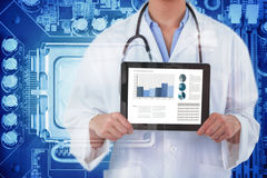Composite image of midsection of female doctor holding digital tablet Royalty Free Stock Photos