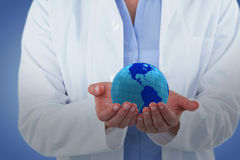 Composite image of midsection of female doctor standing with hands cupped Stock Photo