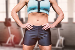 Composite image of midsection of powerful woman with hands on hip Stock Photos