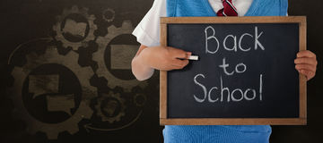 Composite image of midsection of schoolboy holding slate with back to school text. Midsection of schoolboy holding slate with back to school text against Royalty Free Stock Image