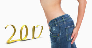Composite image of midsection of slim woman in jeans Royalty Free Stock Image
