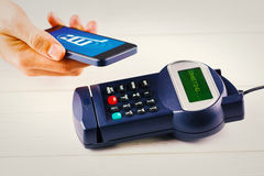 Composite image of mobile over card reader Stock Image