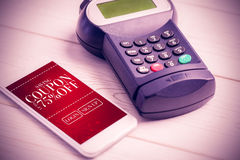 Composite image of mobile payment. Mobile payment against sale advertisement Royalty Free Stock Photos