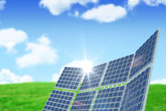 Composite image of modern solar equipment against landscape. Modern solar equipment against white screen against blue sky over green field Stock Image