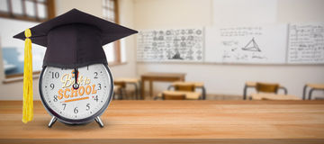 Composite image of mortar board on alarm clock Stock Photos