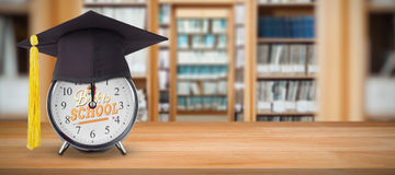 Composite image of mortar board on alarm clock Royalty Free Stock Images