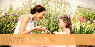 Composite image of mother and daughter collecting easter eggs Royalty Free Stock Image