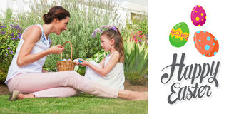 Composite image of mother and daughter collecting easter eggs Royalty Free Stock Images