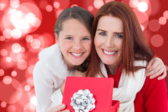 Composite image of mother and daughter with gift Royalty Free Stock Photos