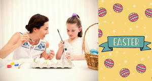 Composite Image Of Mother And Daughter Painting Easter Eggs Stock