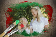 Composite image of mother and daughter in the park Royalty Free Stock Photos