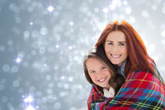 Composite image of mother and daughter under blanket Royalty Free Stock Images