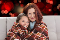 Composite image of mother and daughter under blanket Royalty Free Stock Photography