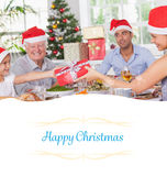 Composite image of mother giving daughter christmas present Stock Photo