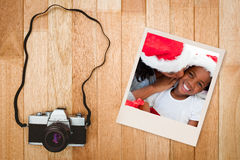 Composite image of mother kissing her daughter at christmas Royalty Free Stock Image