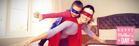 Composite image of mothers day greeting. Mothers day greeting against mother and daughter playing superwoman Royalty Free Stock Photos