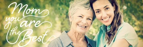 Composite image of mothers day message. Mothers Day message against mother and grandmother smiling in park royalty free stock photography