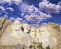 Composite image of Mount Rushmore, U.S. Constitution, and blue sky with white clouds Stock Photos