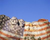 Composite image of Mt. Rushmore and American flag Royalty Free Stock Image