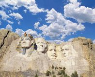 Composite image of Mt. Rushmore with Washington replaced by an Egyptian Pharaoh against blue sky with white puffy clouds Royalty Free Stock Photography