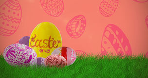 Composite image of multi colored patterned easter eggs Stock Photo