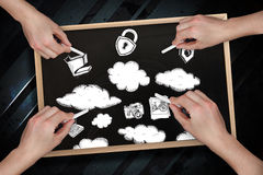 Composite image of multiple hands drawing clouds with chalk Royalty Free Stock Photography