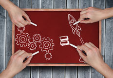 Composite image of multiple hands drawing doodles with chalk Royalty Free Stock Photos