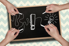 Composite image of multiple hands drawing exclamation mark with chalk Royalty Free Stock Images