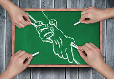 Composite image of multiple hands drawing handshake with chalk Stock Images