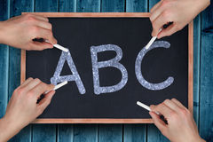 Composite image of multiple hands writing with chalk Royalty Free Stock Photography