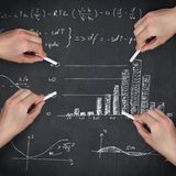 Composite image of multiple hands writing with chalk royalty free stock photo