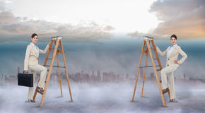Composite image of multiple image of businesswoman climbing ladder Royalty Free Stock Image