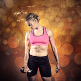 Composite image of muscular woman lifting heavy dumbbell Stock Photos