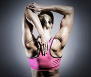 Composite image of muscular woman stretching her arms Stock Photo