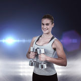 Composite image of  muscular woman working out with dumbbells Stock Image