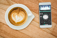 Composite image of music app. Music app against view of a heart composed of coffee Royalty Free Stock Image