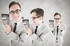 Composite image of nerd with calculator Stock Images