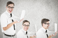 Composite image of nerd with laptop Royalty Free Stock Photos
