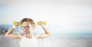 Composite image of nerd lifting weights Royalty Free Stock Photo